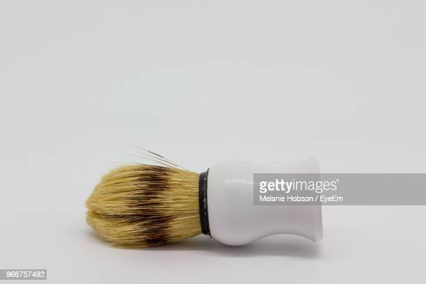 close-up of shaving brush over white background - shaving brush stock photos and pictures