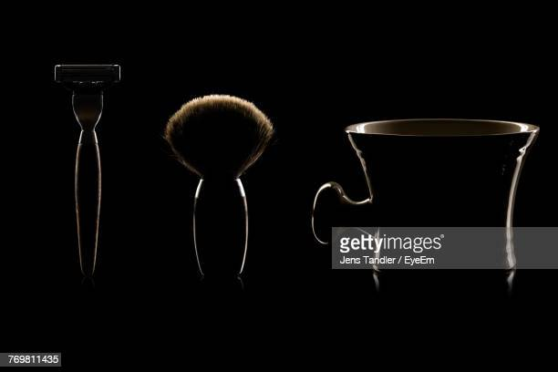 close-up of shaving equipment against black background - shaving brush stock photos and pictures