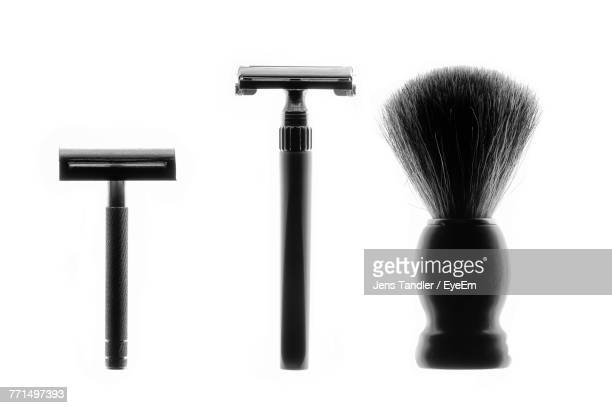 close-up of shaving equipment against white background - shaving brush stock photos and pictures