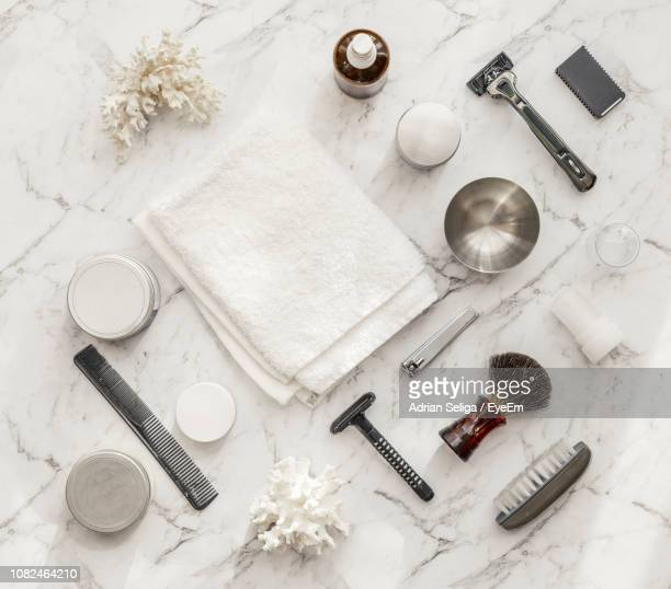close-up of shaving equipment on table - grooming product stock photos and pictures