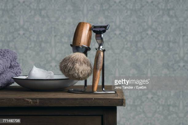 close-up of shaving equipment on table - shaving brush stock photos and pictures