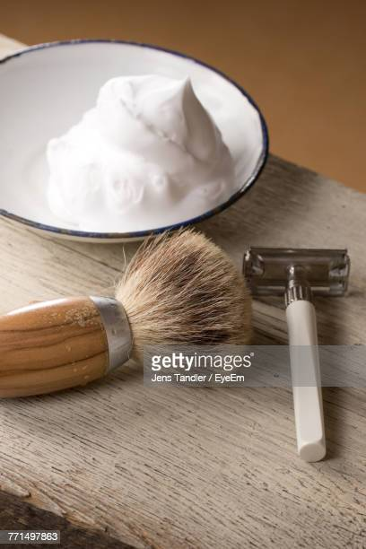 close-up of shaving equipment on table - shaving cream stock photos and pictures