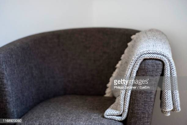 close-up of shawl on armchair against wall at home - ストール ストックフォトと画像