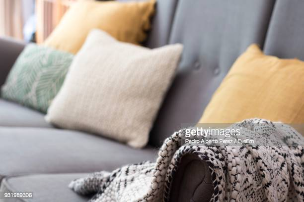close-up of shawl on sofa at home - cushion stock photos and pictures