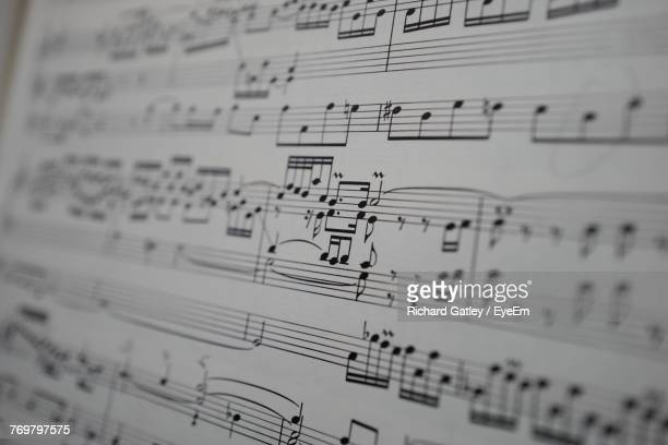 close-up of sheet music - musical note stock photos and pictures