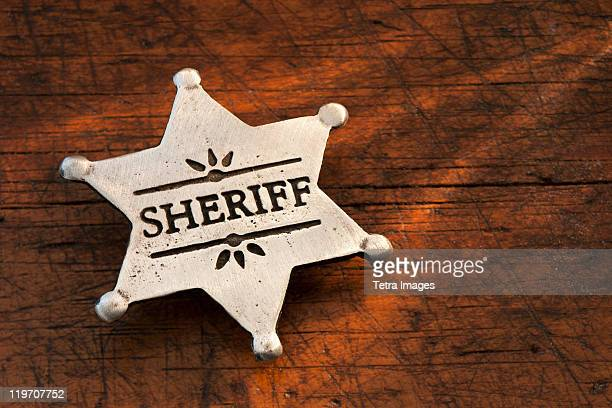 close-up of sheriff badge - sheriff stock pictures, royalty-free photos & images