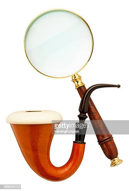 close-up of sherlock holmes pipe and magnifier - sherlock holmes stock pictures, royalty-free photos & images