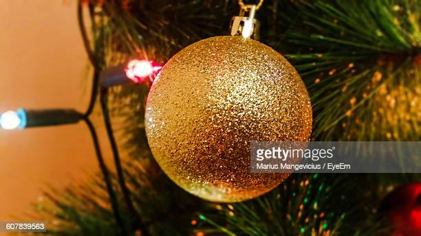 Close-Up Of Shiny Bauble Hanging On Christmas Tree