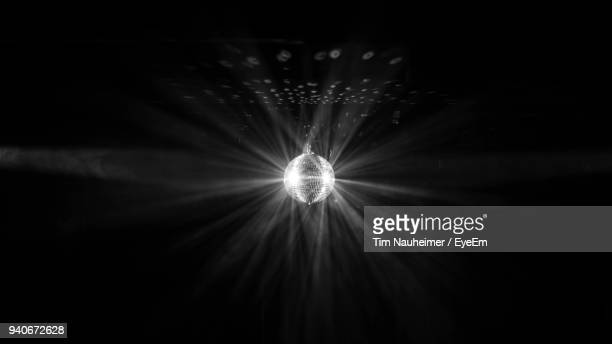 close-up of shiny disco ball in nightclub - disco ball stock photos and pictures