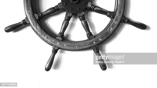 Close-Up Of Ship Helm Mounted On White Wall