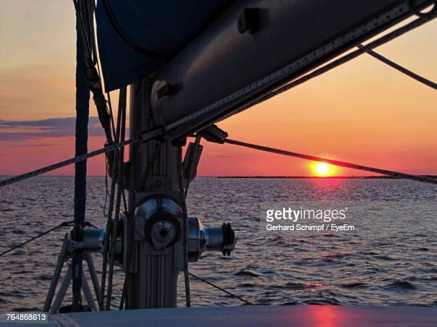 close-up of ship sailing on sea against sky during sunset - gerhard schimpf stock pictures, royalty-free photos & images