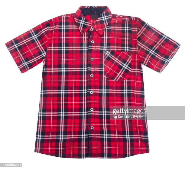 close-up of shirt against white background - plaid shirt stock pictures, royalty-free photos & images