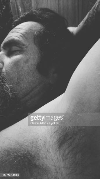 close-up of shirtless man sleeping at home - male armpits stock pictures, royalty-free photos & images