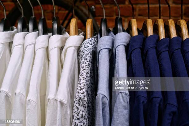 close-up of shirts hanging at store - menswear stock pictures, royalty-free photos & images