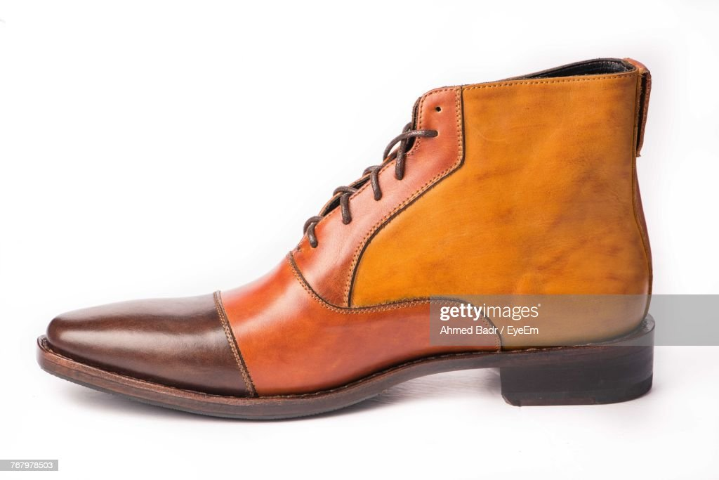 Close-Up Of Shoe Over White Background : Stock Photo