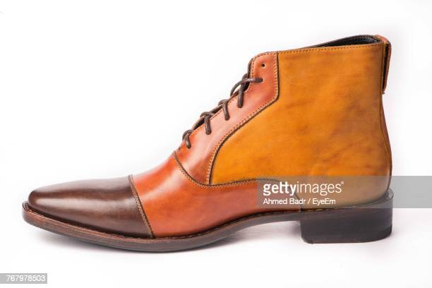 close-up of shoe over white background - calzature di pelle foto e immagini stock