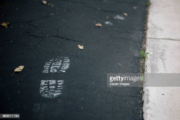 close-up of shoe print on road - shoe print stock pictures, royalty-free photos & images