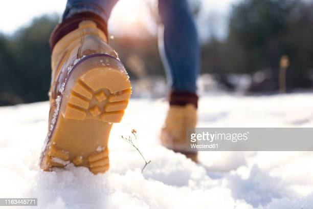 close-up of shoe sole in winter - snow boot stock pictures, royalty-free photos & images
