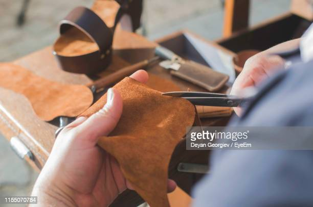 close-up of shoemaker making sandal at workshop - leather shoe stock pictures, royalty-free photos & images
