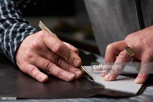 close-up of shoemaker working on template in his workshop - schuhmacher stock-fotos und bilder