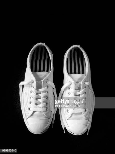 close-up of shoes against black background - white shoe stock pictures, royalty-free photos & images