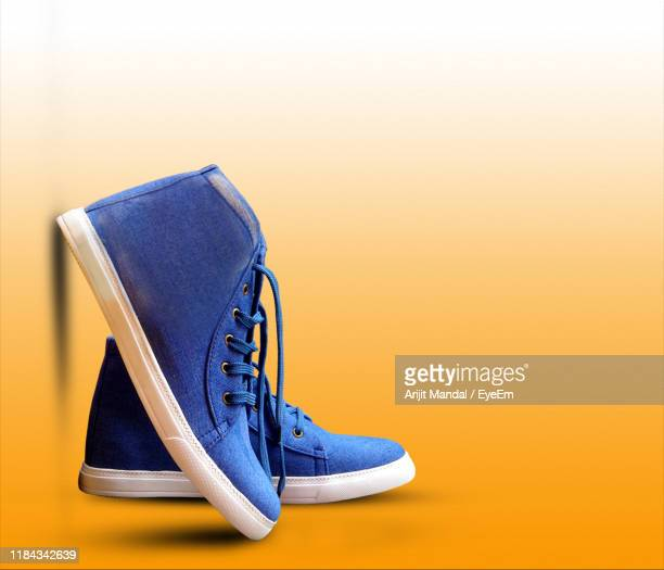 close-up of shoes against colored background - menswear stock pictures, royalty-free photos & images