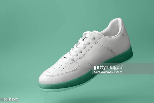 close-up of shoes against green background - chaussures photos et images de collection