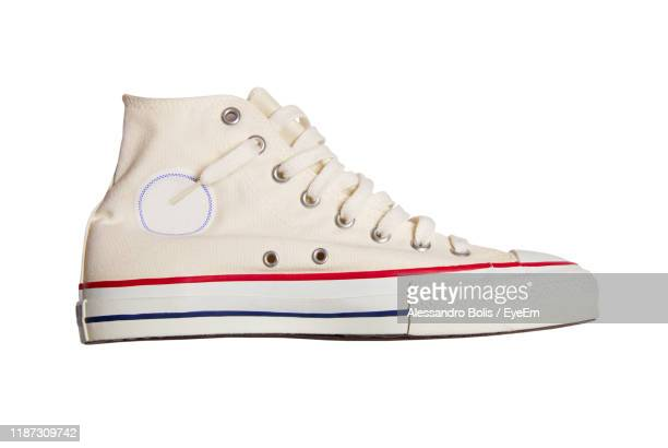 close-up of shoes against white background - white shoe stock pictures, royalty-free photos & images