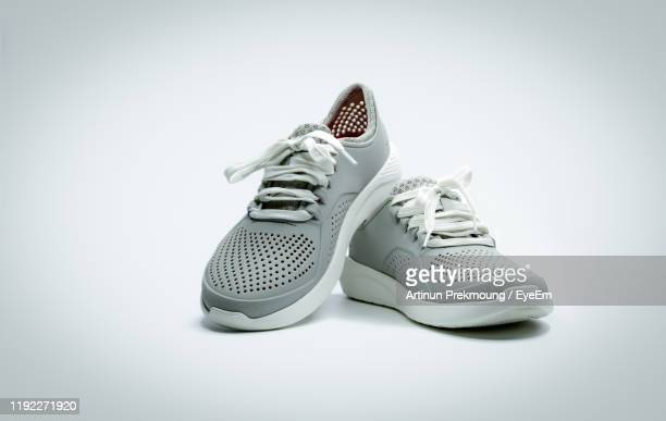 close-up of shoes against white background - gray shoe stock pictures, royalty-free photos & images