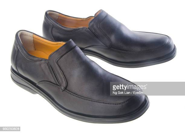 close-up of shoes against white background - black shoe stock pictures, royalty-free photos & images
