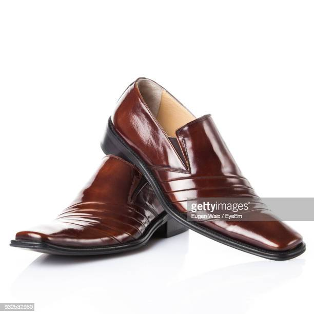 close-up of shoes against white background - brown shoe stock photos and pictures