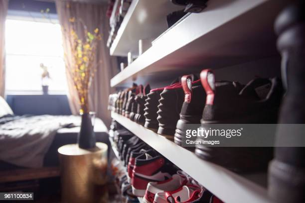 close-up of shoes arranged in shelf at home - 片付いた部屋 ストックフォトと画像