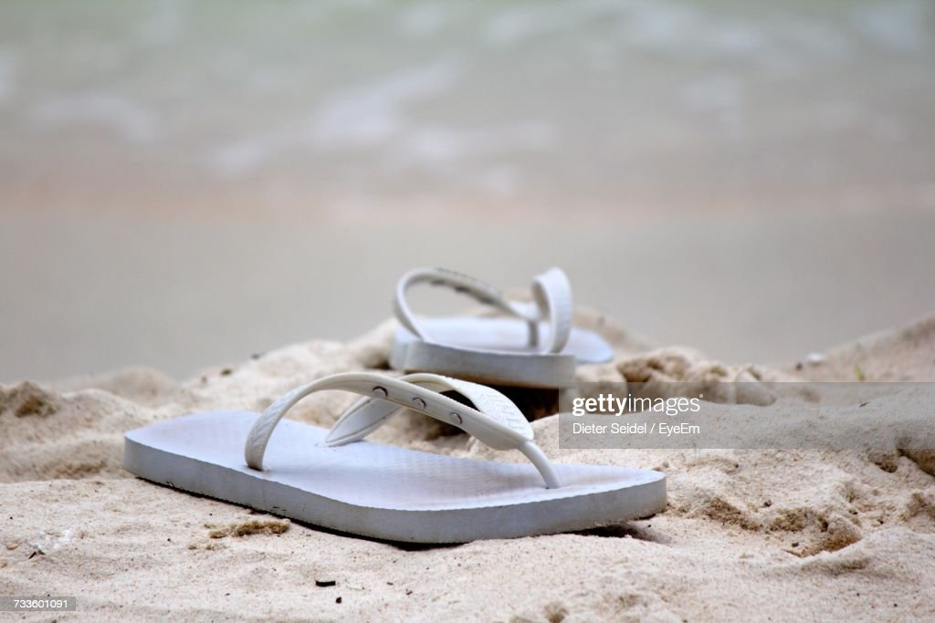 Close-Up Of Shoes On Beach : Stock Photo