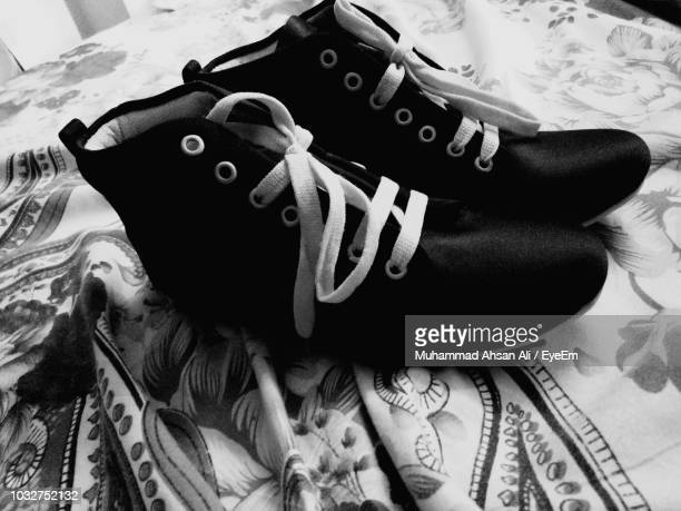 Close-Up Of Shoes On Bed
