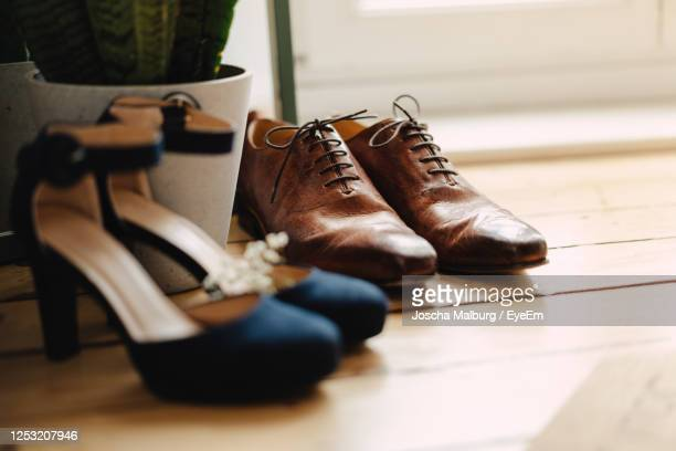 close-up of shoes on floor - brown shoe stock pictures, royalty-free photos & images