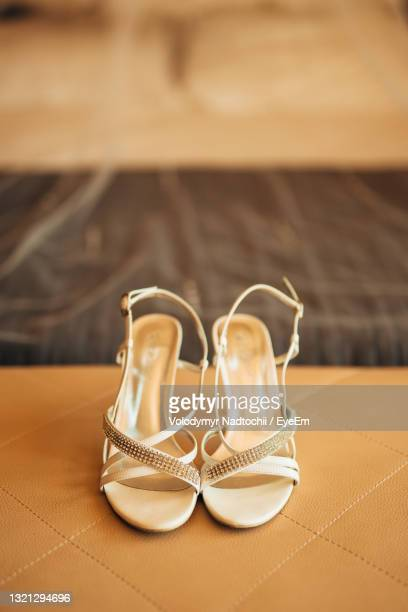 close-up of shoes on table - open toe stock pictures, royalty-free photos & images