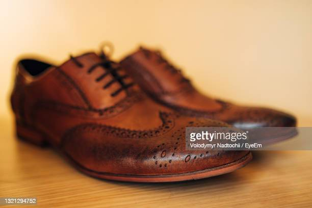 close-up of shoes on table - lino stock pictures, royalty-free photos & images