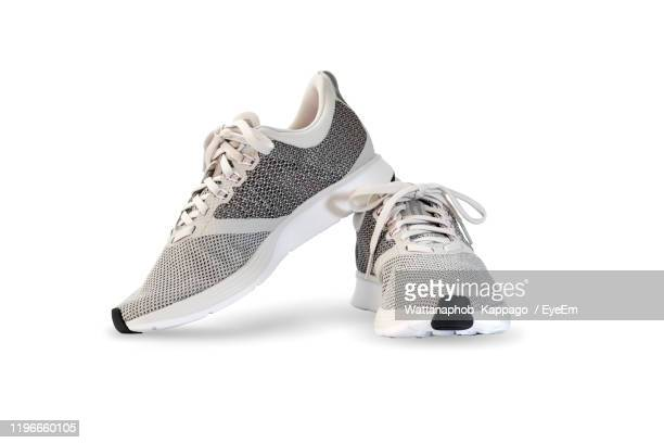 close-up of shoes on white background - gray shoe stock pictures, royalty-free photos & images