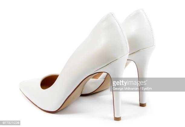 close-up of shoes on white background - talons hauts photos et images de collection