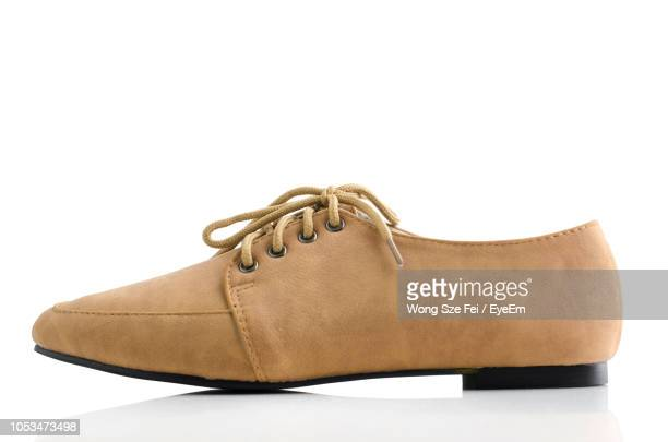 close-up of shoes over white background - brown purse stock pictures, royalty-free photos & images