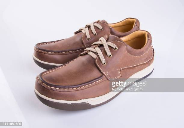 close-up of shoes over white background - brown shoe ストックフォトと画像