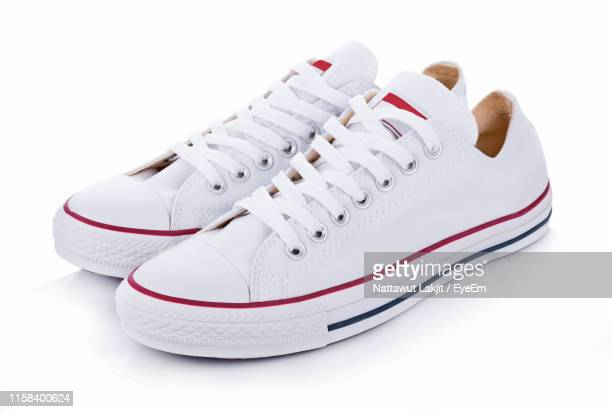 close-up of shoes over white background - white shoe stock pictures, royalty-free photos & images