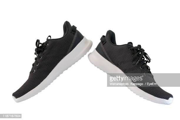 close-up of shoes over white background - black shoe stock pictures, royalty-free photos & images