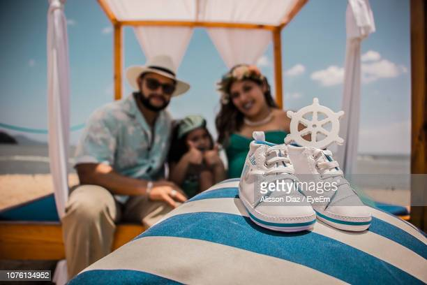 close-up of shoes with family in background - alisson stock pictures, royalty-free photos & images