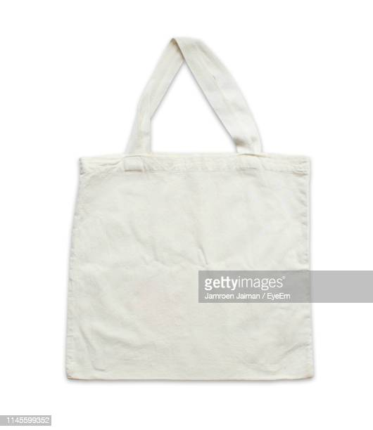 close-up of shopping bag against white background - shopping bag stock pictures, royalty-free photos & images