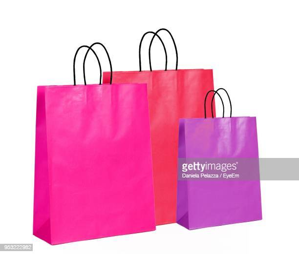 close-up of shopping bags against white background - shopping bag stock pictures, royalty-free photos & images
