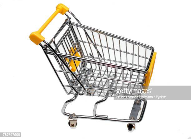Close-Up Of Shopping Cart Against White Background