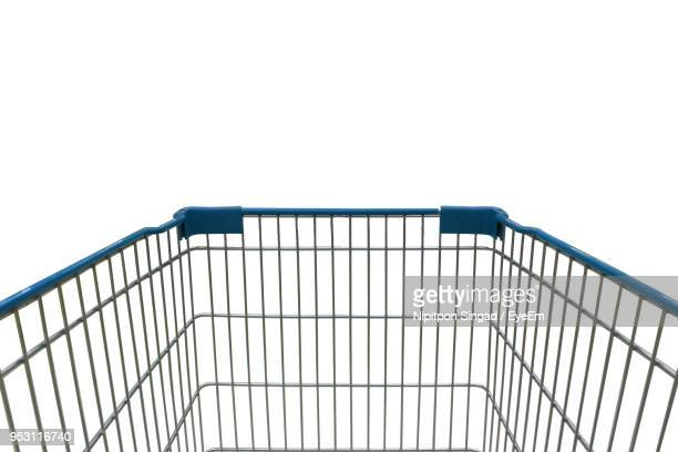 close-up of shopping cart against white background - shopping cart stock pictures, royalty-free photos & images