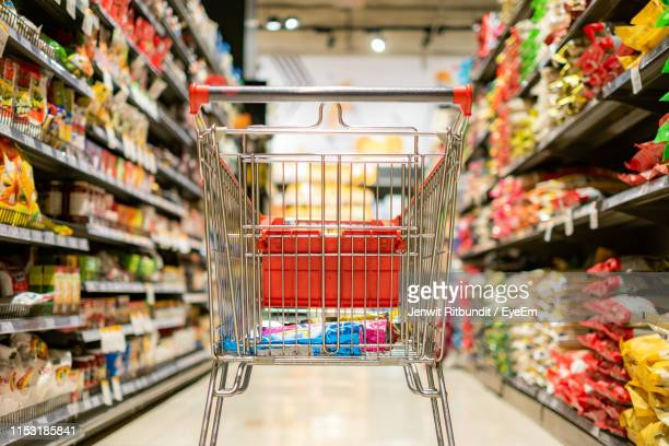 close-up of shopping cart in supermarket - shopping trolley stock pictures, royalty-free photos & images