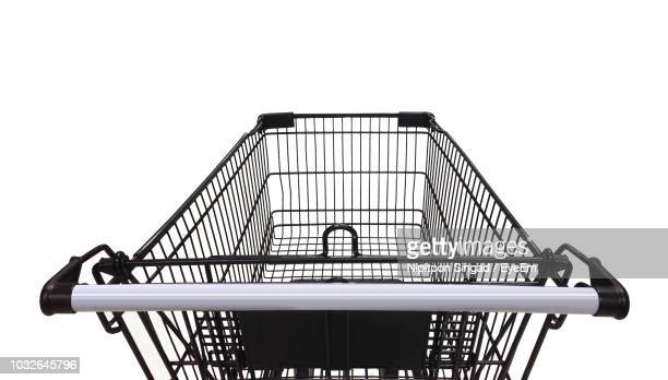 close-up of shopping cart over white background - shopping cart stock pictures, royalty-free photos & images